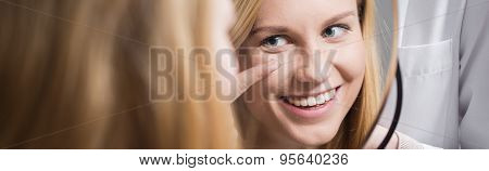 Female Putting In Contact Lens