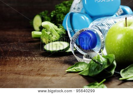 Fresh healthy vegetables, water and measuring tape. Health, sport and diet concept