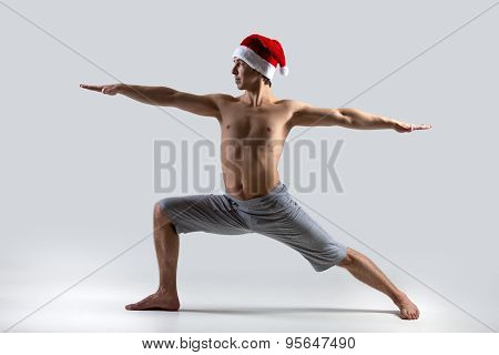 Yoga Pose Warrior 2 In Santa Claus Hat