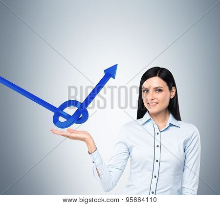 Brunette Business Woman Holds A Knot From A Blue Arrow