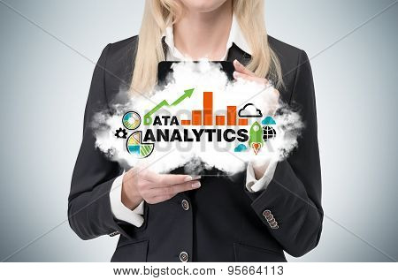 Blonde Business Woman Holds A Tablet With Cloud And Analytical Chart.