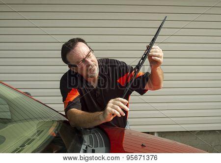Mechanic Installing A New Wiper Blade