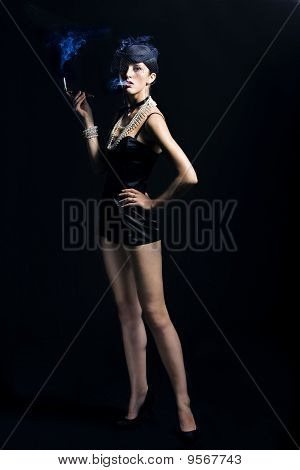 Woman With Cigarette And Vintage Hat With Long Legs