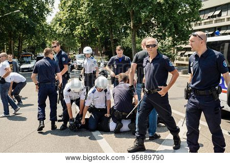 Police arresting man during protest