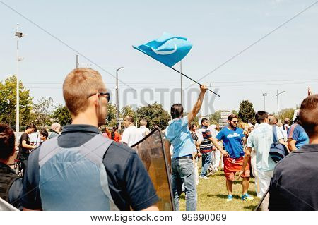 Man Waving East Turkistan Flag At Protest