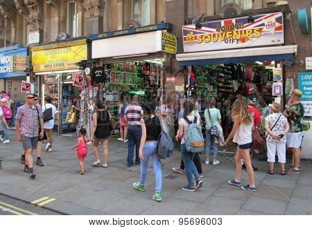 LONDON- 4 JULY: Tourists enjoying the landmarks and souvenir shops, in londons piccadilly circus, during the recent heatwave. LONDON, 4 JULY, 2015.
