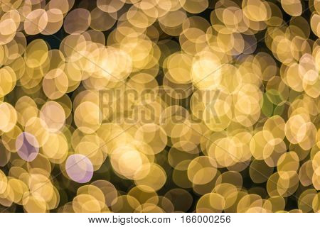 Abstract golden sparkle background De-focused bokeh abstract Christmas copy space Shimmering blue spotlights defocused golden lights New Years disco party