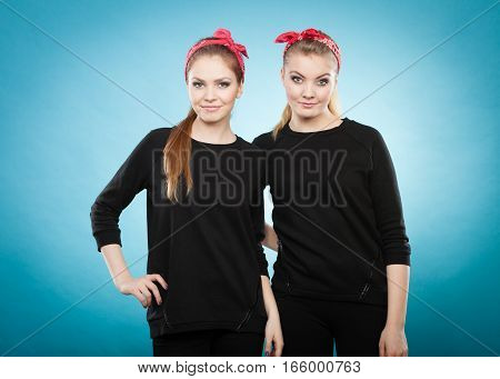 Retro and vintage style. Old fashion. Portrait of lovely pretty young women in pin up hairstyle with red handkerchief on head.