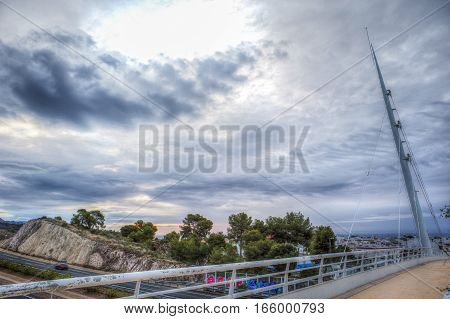 Nerja Spain - december 5 2016: Modern pedestrian bridge over Costa del Sol freeway Nerja Spain