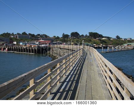 A pier extending into the bay in Old Town Bandon on Oregon's Central Coast on a summer day.