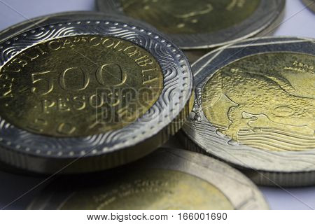 500 Colombian pesos coins. Macro of coins composition.