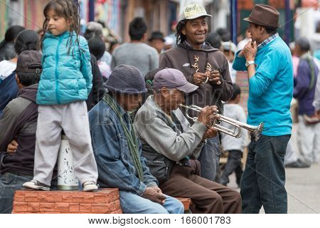 August 27 2016 Otavalo Ecuador: a man is playing his trumpet in the street of the indigenous town