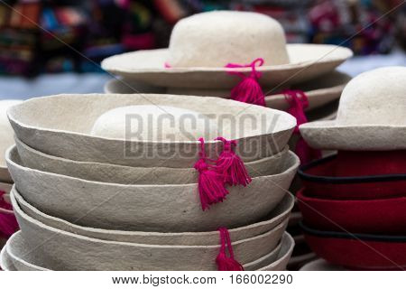 traditional indigenous felt hats in the Otavalo artisan market which is held on Saturdays