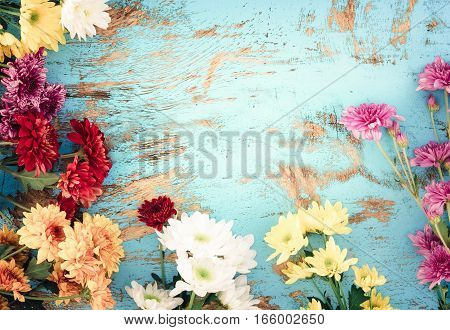 Colorful flowers bouquet on vintage wooden background border design. vintage color tone - concept flower of spring or summer background