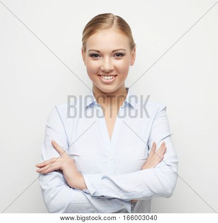 lifestyle, business and people concept: Portrait of happy young business woman over white background