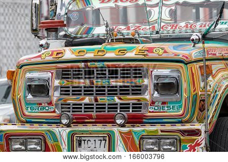 September 6 2016 Silvia Colombia: closeup details of a vintage colourful public transportation bus called 'chivas'