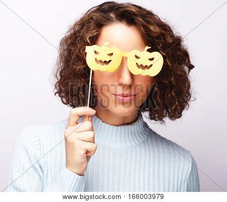 lifestyle, fashion and people concept: playful young happy  woman ready for party