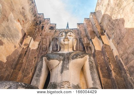 Buddha image in Wat Sri Chum temple at Sukhothai Historical Park, Thailand.