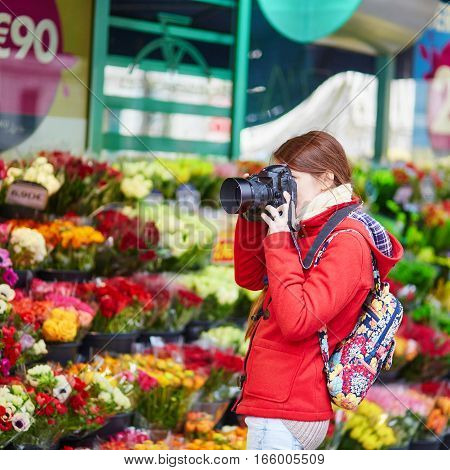 Woman Taking Photo In Parisian Flower Shop Or On Market