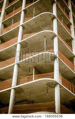 Multi-story building under construction, closeup view .