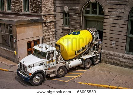 Montreal, Canada, July 5, 2007: A concrete mixer construction truck is making a delivery.