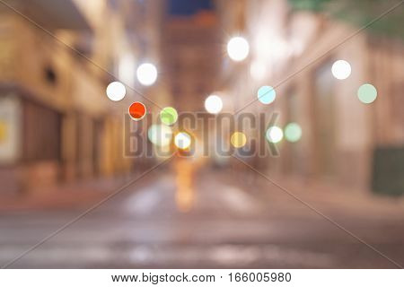 Background abstract image gritty street and building scene at night long exposure blurred defocused image Alicante Spain.