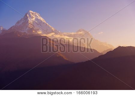 View of Annapurna and Machapuchare peak at Sunrise from Poon Hill, Nepal. poster