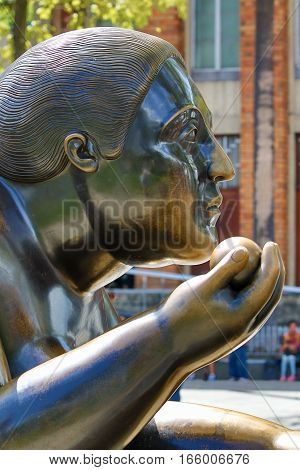 October 16 2016 Medellin Colombia: closeup details of a woman's head one of Botero's surrealist statues publicly displayed in the city center