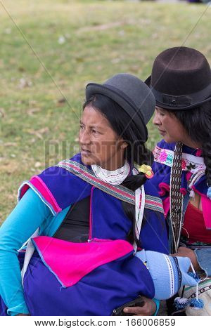 September 6 2016 Silvia Colombia: indigenous Guambiano woman in traditional clothing holding a baby in her arms outdoors