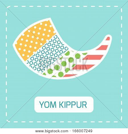 Yom kippur symbol shofar made from different pattern fabric pieces.