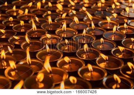 Lighting a lamp for peace from Shree Boudhanath Kathmandu ,Nepal.