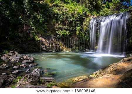 Long Exposure of Oakley Creek Waterfall on a bright Summers Day Auckland New Zealand - Side View