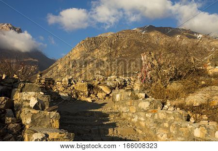 Path in mountains to Buddhist Temple in Muktinath, Himalayas, Nepal