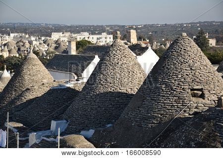 Beautiful aerial view of the traditional trulli houses with their conical roof in Alberobello, Apulia, Italy