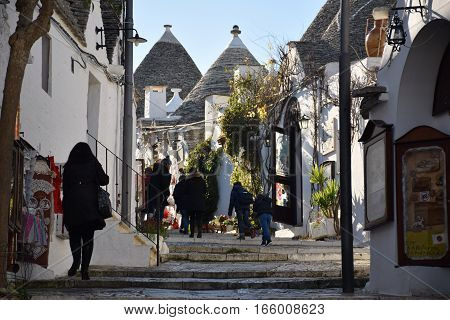 ALBEROBELLO, APULIA, ITALY - JANUARY 02, 2017 - Beautiful view of the traditional trulli houses with their conical roof on january 02, 2017 in Alberobello