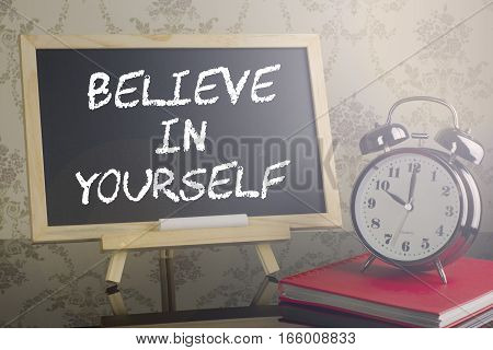 Believe In Yourself On Blackboard With Flare And Clock.