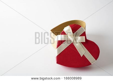 Gift box on the white background. Red ribbon. Valentines Day gift. Isolated