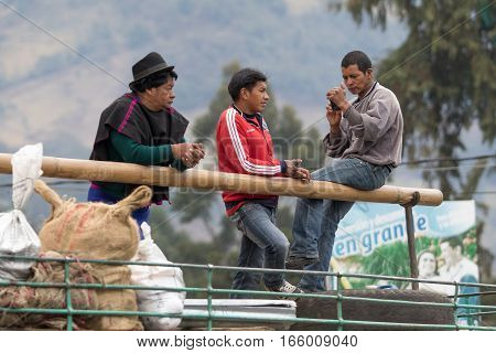 September 6 2016 Silvia Colombia: indigenous men standing on the top of a bus on market day