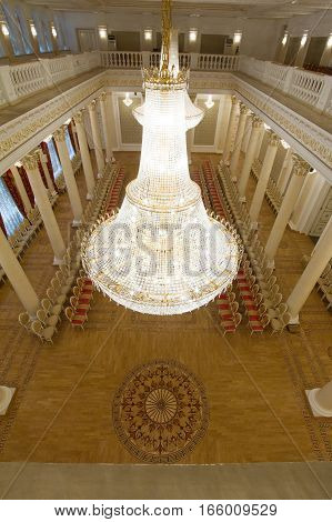 KAZAN, RUSSIA - 16 JANUARY 2017, City Hall - luxury and beautiful touristic place - golden ballroom and crystal chandelier, wide angle
