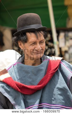 September 6 2016 Silvia Colombia: outdoors portrait of a Guambiano indigenous man dressed in traditional clothing and a Bowler hat in the Tuesday market