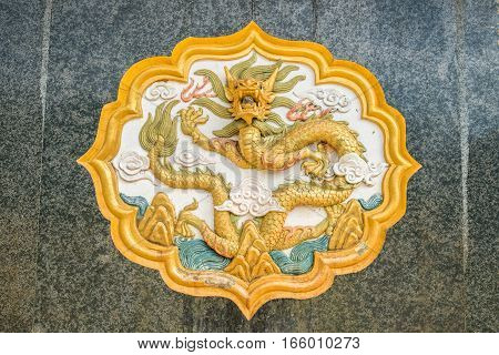 Chinese dragon sculpture decoration in Chinese soldier museum monument on Doi Mae Salong of Chiangrai province, Thailand.