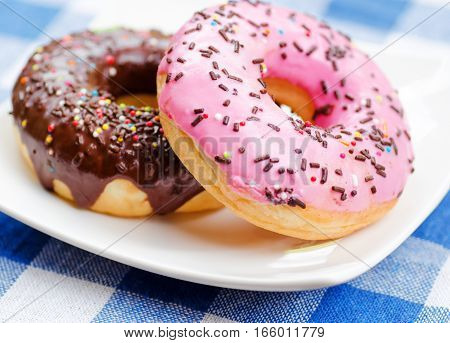Pink And Chocolate Delicious Fresh Donuts On White Plate