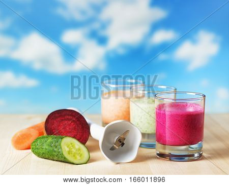 Vegetable Smoothie On Wooden Table On The Skyl Background