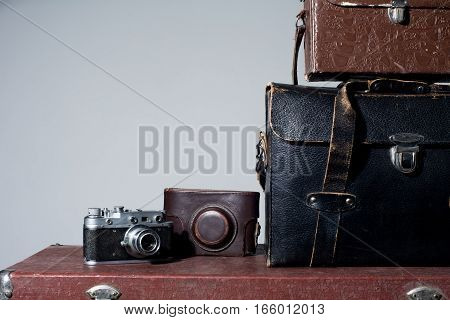 Camera And Carrying Case On Old Suitcase