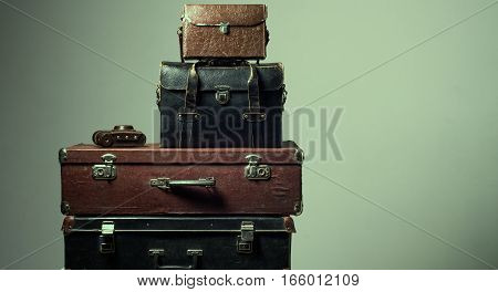 Background Stack Of Old Shabby Suitcases And Camera