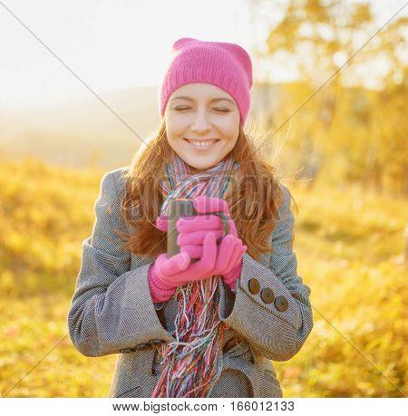 Young Woman Enjoying The Fall Season. Autumn Outdoor Portrait