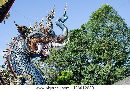 Serpent or God of Snake Thai Tradition with Blue Sky at Wat Rong Sua Ten Chiang Rai Thailand. Most Visited from Tourist.