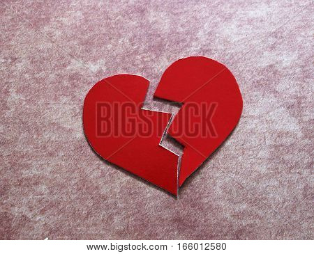 Paper broken heart breakup concept separation and divorce