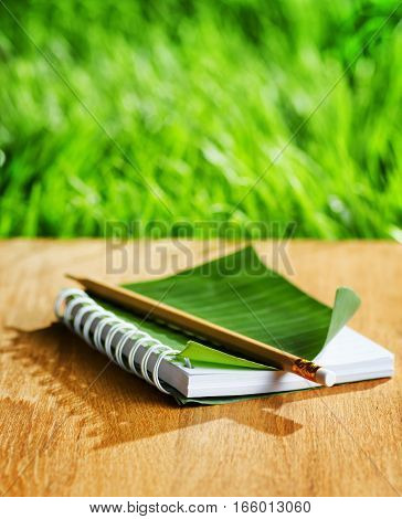 Notepad Lies On Wooden Board