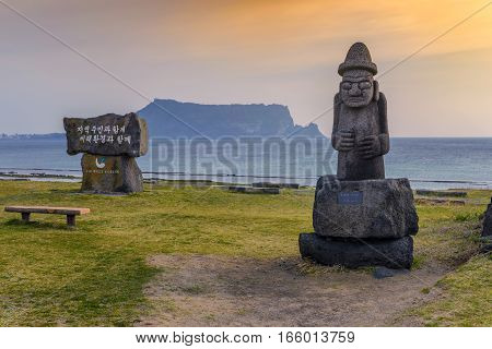 Dol hareubang statue and Jeju-do Seongsan Ilchulbong Jeju Island South Korea